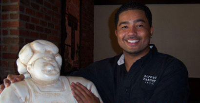 Photo of Corner Bakery Cafe Employee and Statue